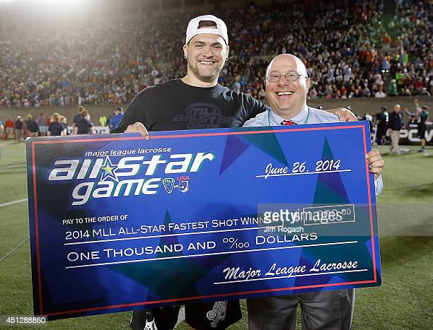 Commissioner David Gross stands with Zach Dorn a spectator who won the 2014 MLL AllStar Fastest Shot Contest at half time of the 2014 MLL All Star...