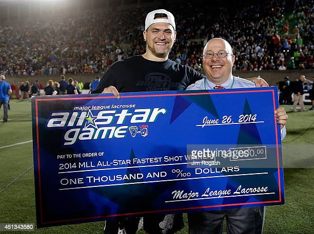 Commissioner David Gross stands with Zach Dorn a spectator who won the 2014 MLL AllStar Fastest Sot Contest at half time of the 2014 MLL All Star...