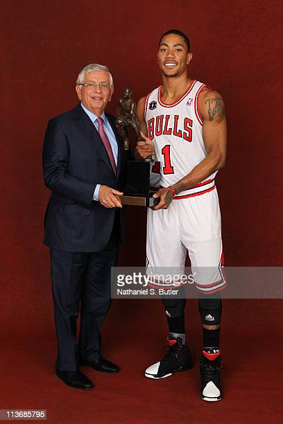 Commissioner David Stern and 2011 NBA MVP Derrick Rose of the Chicago Bulls pose with the KIA Motors NBA MVP Trophy on May 4 2011 in the 2011 NBA...
