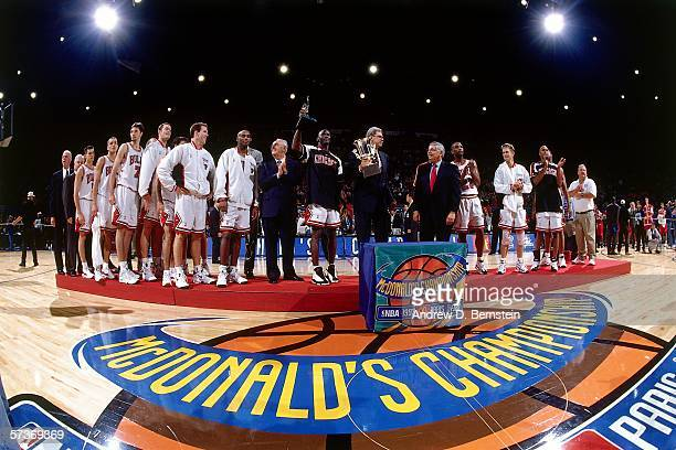 Commissioner David Stern and Boris Stankovic of FIBA presents the Chicago Bulls stand at the podium during the awards presentation following the game...