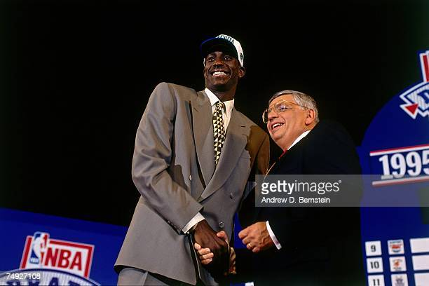 Commissioner David Stern and Minnesota Timberwolves first round draft pick Kevin Garnett pose for a photo at the 1995 NBA draft on June 28, 1995 at...