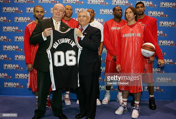 Commissioner David Stern and Ralf Bemd Assenmacher of Germany pose for a photo in front of Tony Parker Shawn Marion Andre Iguodala Elton Brand Steve...