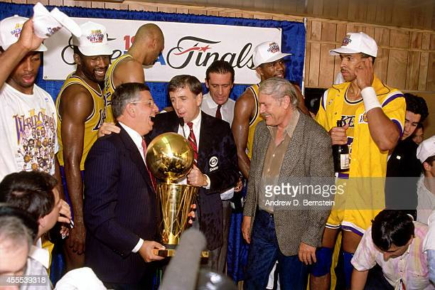 Commissioner David Stern awards Los Angeles Lakers owner Jerry Buss the 1988 NBA Championship Trophy after defeating the Detroit Pistons in Game 7 of...