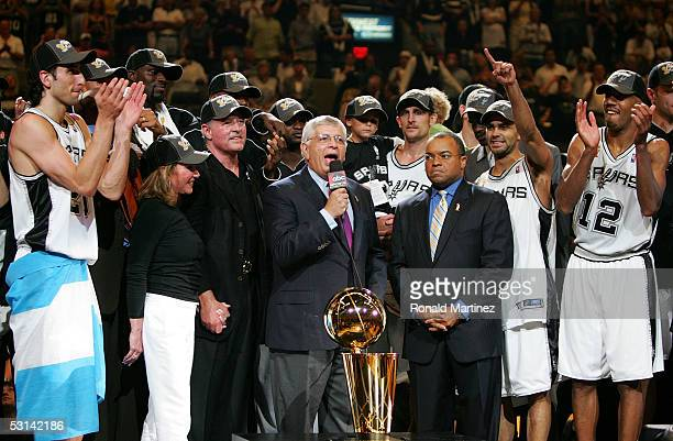 Commissioner David Stern, center, presents the Larry O'Brien trophy to the San Antonio Spurs after they defeated the Detroit Pistons in Game seven of...
