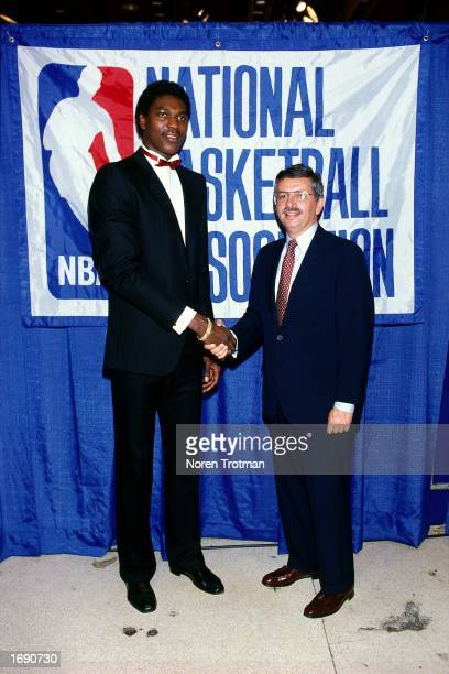 Commissioner David Stern congratulates Akeem Olajuwon after being drafted first overall by the Houston Rockets during the 1984 NBA Draft. NOTE TO...