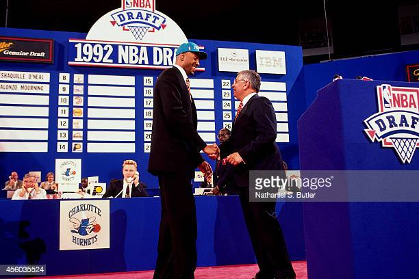 Commissioner David Stern congratulates Alonzo Mourning after being drafted number 2 overall by the Charlotte Hornets at the NBA Draft in Portland...