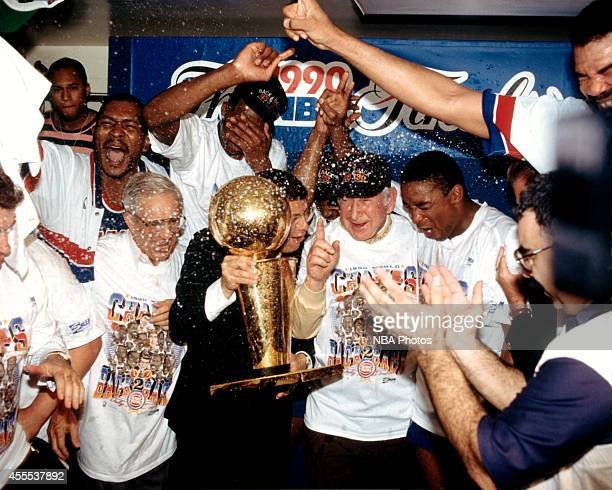 Commissioner David Stern delivers the 1990 NBA Championship trophy Detroit Pistons owner Bill Davidson and players after defeating the Portland Trail...
