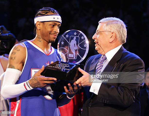 Commissioner David Stern hands Allen Iverson of the Eastern Conference team the AllStar Most Valuable Player trophy after the NBA AllStar game 20...