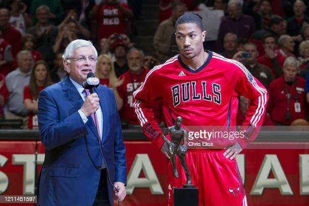 Commissioner David Stern presents Derrick Rose of the Chicago Bulls with the KIA Motors NBA MVP Trophy prior to Game Two of the Eastern Conference...