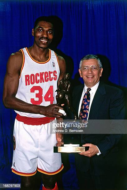 Commissioner David Stern presents Hakeem Olajuwon of the Houston Rockets the 1993 MVP Award prior to Game Two of the Western Conference Semifnals on...