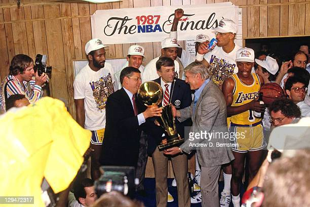 Commissioner David Stern presents Jerry Buss the 1987 NBA Finals Championship trophy following Game Six of the 1987 NBA Finals on June 14 1987 at the...