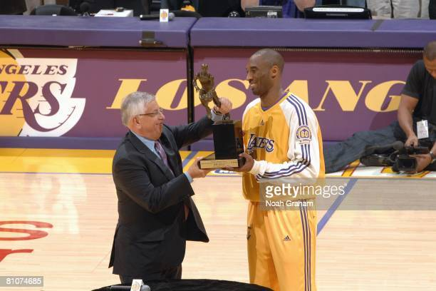 Commissioner David Stern presents Kobe Bryant of the Los Angeles Lakers with the 200708 NBA Most Valuable Player award before Game Two of the Western...