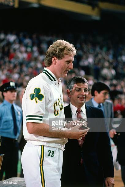 Commissioner David Stern presents Larry Bird of the Boston Celtics with his ring during the 1984 NBA Championship Ring Ceremony prior to a game...