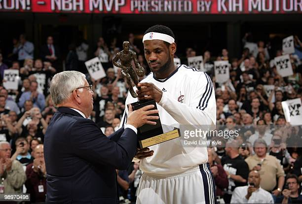 Commissioner David Stern presents LeBron James of the Cleveland Cavaliers with his Maurice Podoloff Trophy in recognition for being named the 200910...