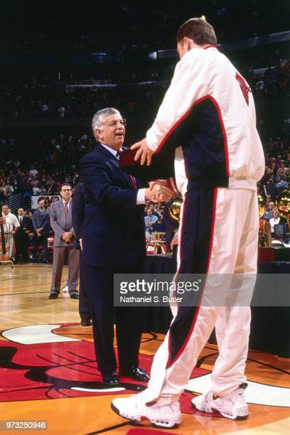 Commissioner David Stern presents Luc Longley of the Chicago Bulls with a championship ring during a game played on November 1 1997 at the First...