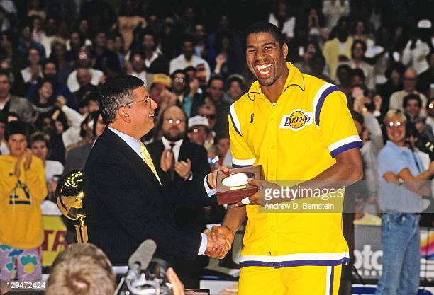 Commissioner David Stern presents Magic Johnson his 1987 NBA Championship riing circa 1987 at the Great Western Forum in Inglewood California NOTE TO...