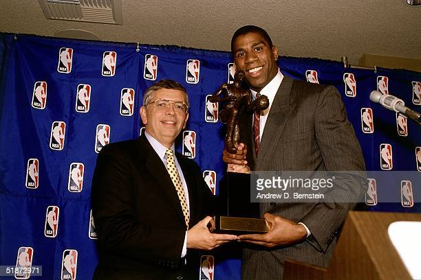 Commissioner David Stern presents Magic Johnson of the Los Angeles Lakers the MVP award circa 1989 in Los Angeles California NOTE TO USER User...