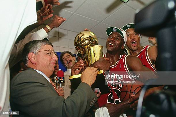 Commissioner David Stern presents Michael Jordan and the Chicago Bulls the championship trophy after the Bulls defeated the Phoenix Suns in Game Six...