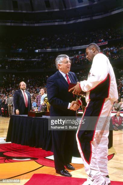 Commissioner David Stern presents Randy Brown of the Chicago Bulls with a championship ring during a game played on November 1 1997 at the First...