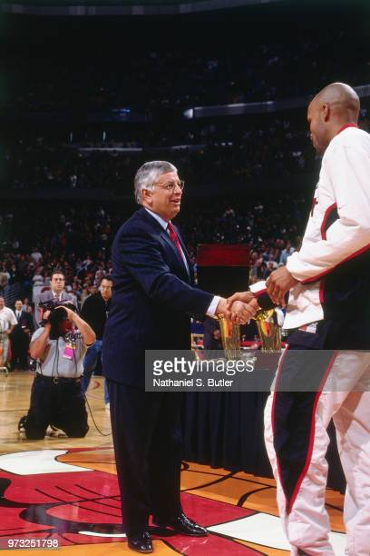 Commissioner David Stern presents Ron Harper of the Chicago Bulls with a championship ring during a game played on November 1 1997 at the First Union...