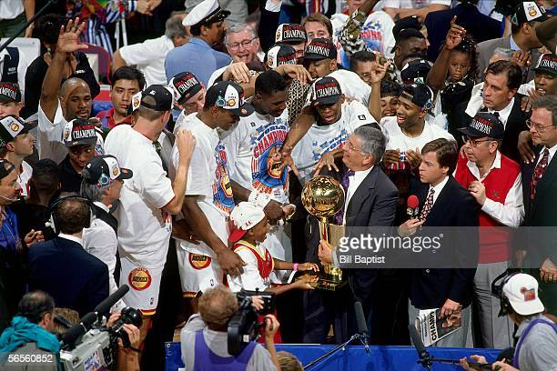 Commissioner David Stern presents the championship trophy to the Houston Rockets as they celebrate defeating the New York Knicks in game 7 of the...