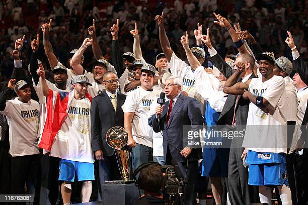Commissioner David Stern presents the Larry O'Brien trophy to the Dallas Mavericks founder Don J Carter next to team owner Mark Cuban after the...