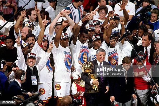 Commissioner David Stern presents the Rockets with the Championship Trophy after defeating the New York Knicks in game 7 of the 1994 NBA Finals on...