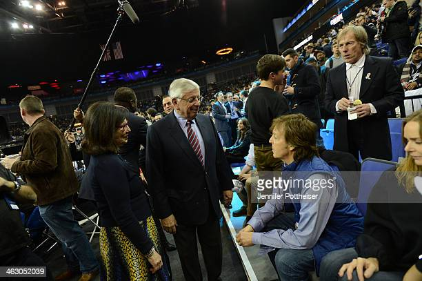 Commissioner David Stern speaks to Sir Paul McCartney prior to the game of the Brooklyn Nets against the Atlanta Hawks as part of the 2014 Global...