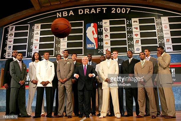 Commissioner David Stern throws a basketball at the media while posing with Al Horford Acie Law IV Joakim Noah Nick Young Kevin Durant Corey Brewer...