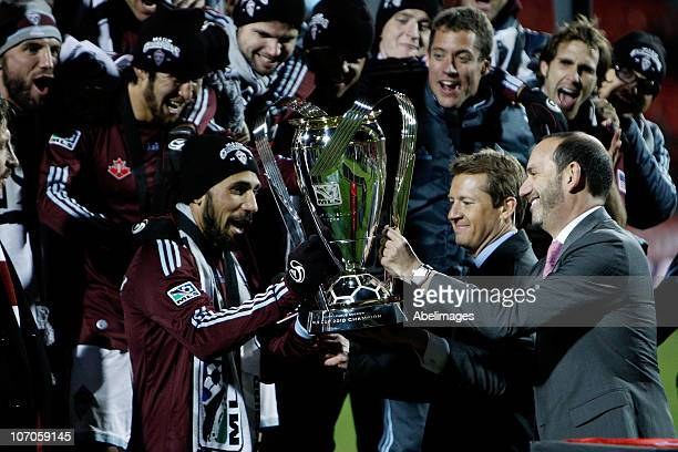 Commissioner Don Garber hands the Philip F Anschutz Trophy to Captain Pablo Mastroeni of the Colorado Rapids who accepts it on behalf of the team in...