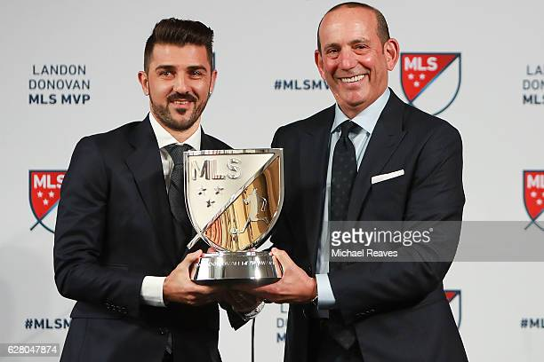 MLS commissioner Don Garber presents the 2016 Landon Donovan MLS MVP trophy to David Villa of New York City FC at Spring Studios on December 6 2016...