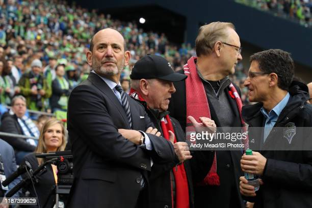 Commissioner Don Garber, Toronto FC owners Larry Tanenbaum and George Cope, and Seattle Sounders FC owner Adrian Hanauer wait for the players to...