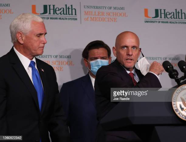 Commissioner Dr Stephen Hahn prepares to speak as Vice President Mike Pence and Florida Gov Ron DeSantis look on during a press conference at the...