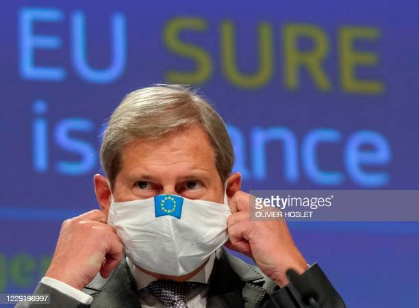 Commissioner for Budget Johannes Hahn gives a press conference on the first insurance of EU social bonds under the temporary support to mitigate...