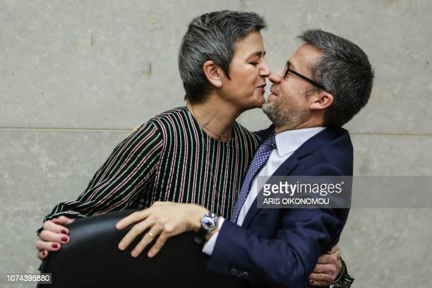 Commissioner for Competition Margrethe Vestager and EU Research, Science and Innovation Commissioner Carlos Moedas laugh together prior to the EU...