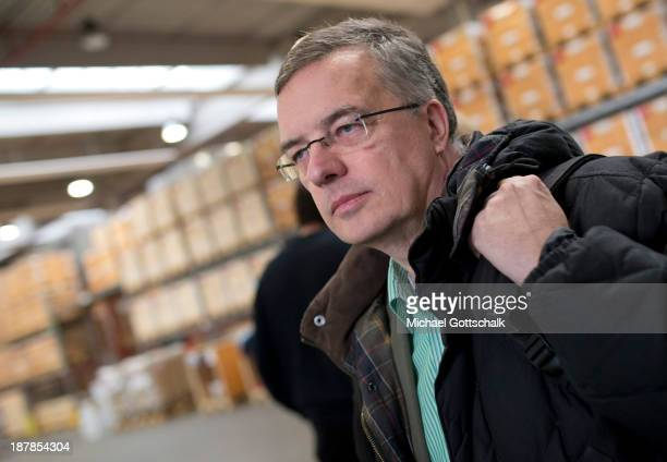 Commissioner for human rights of the German government Markus Loening watches as German technical relief organisation THW and the German Red Cross...