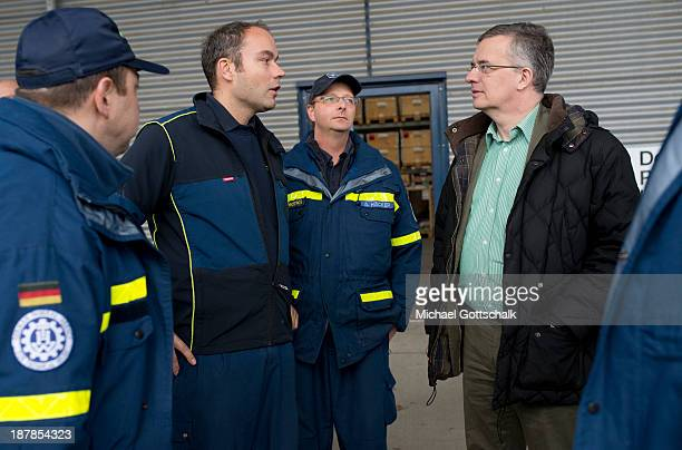 Commissioner for human rights of the German government Markus Loening speaks to members of the German technical relief organisation THW and the...