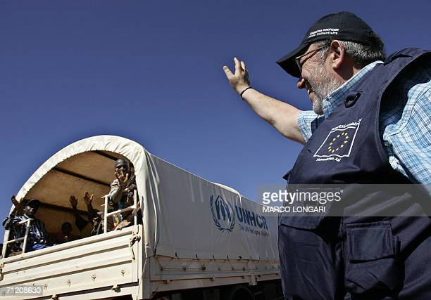 Commissioner for Humanitarian Affairs Louis Michel bids farewell 15 June 2006 to a group of Burundian refugees departing from Mtabila refugee camp in...