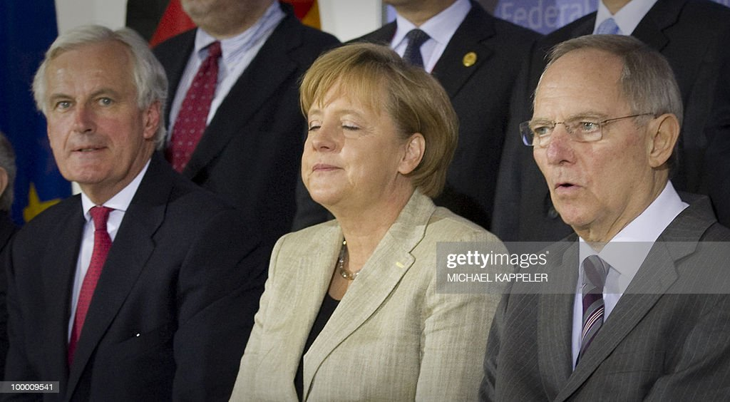 EU commissioner for Internal Market and Services Michel Barnier, German Chancellor Angela Merkel and German Finance minister Wolfgang Schaeuble pose for a group picture during a conference on financial regulation on May 20, 2010 at the Finance Ministry in Berlin. Merkel said she would lead a campaign for a tax on financial markets at the next meeting of the Group of 20 developed economies in June 2010 and called for international support.