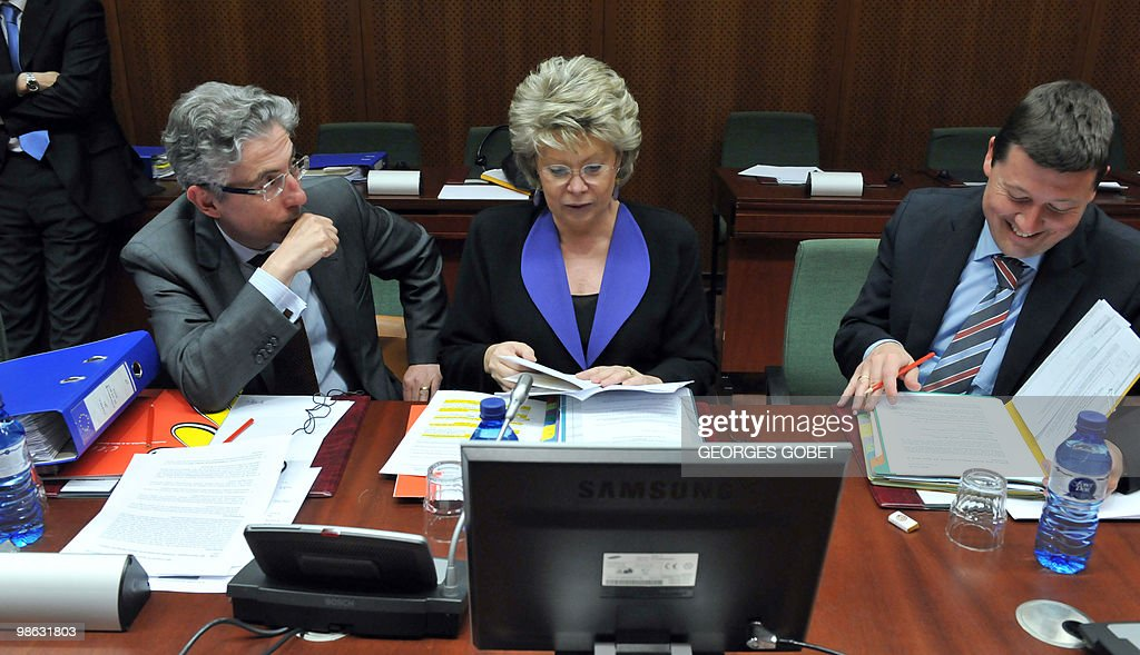 EU commissioner for Justice, Fundamental Rights and Citizenship Viviane Reding (C) talk with advisors prior to the Justice and Home Affairs Council meeting on April 23, 2010 at the EU headquarters in Brussels.
