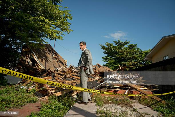 Commissioner Francis Suarez in front of remains of a demolished vacant property in the neighborhood known as Allapattah in Miami The city is taking a...