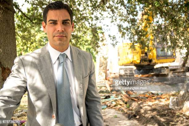 Commissioner Francis Suarez in front of remains of a demolished vacant property in the neighborhood known as Model City in Miami The city is taking a...