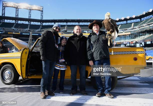 Commissioner Gary Bettman and guests pose for a picture with the eagle Challenger and its falconer prior to the 2018 Bridgestone NHL Winter Classic...