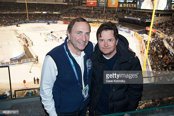 Commissioner Gary Bettman and Michael J Fox attend the 2014 NHL Stadium Series at Yankee Stadium on January 29 2014 in New York City