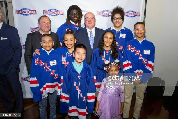 February 6: NHL Commissioner, Gary Bettman , and NHL Deputy Commissioner, Bill Daly , pose for a photograph with members of Ice Hockey in Harlem...