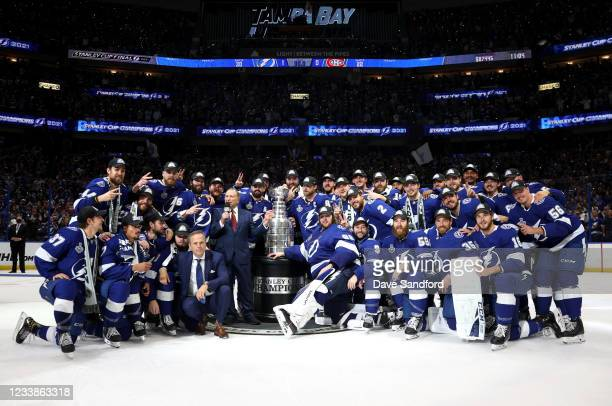 Commissioner Gary Bettman and Tampa Bay Lightning team stand around the Stanley Cup after the Lightning 1-0 victory in Game Five of the 2021 Stanley...