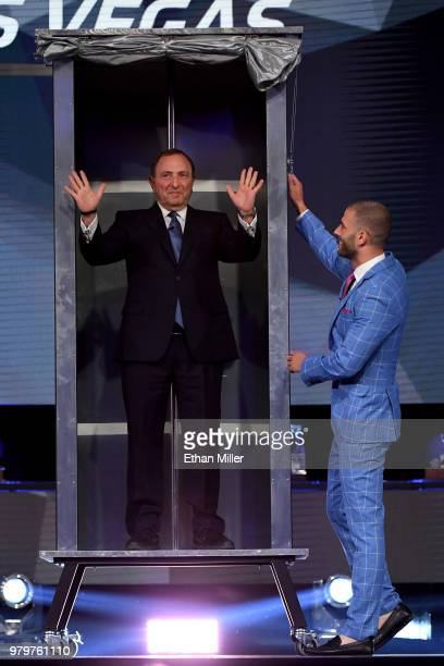 Commissioner Gary Bettman helps illusionist Darcy Oake perform a magic trick onstage at the 2018 NHL Awards presented by Hulu at The Joint inside the...
