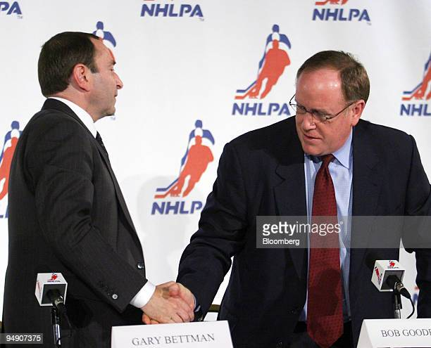 Commissioner Gary Bettman left and Bob Goodenow executive director of the NHL Players' Association shake hands at a news conference Thursday July 21...