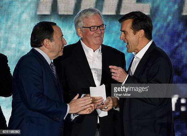 NHL Commissioner Gary Bettman majority owner Bill Foley and general manager George McPhee talk as the Vegas Golden Knights is announced as the name...