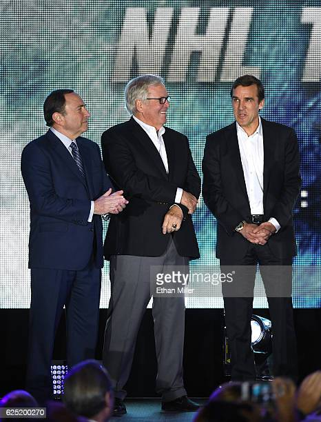 NHL Commissioner Gary Bettman majority owner Bill Foley and general manager George McPhee talk before the Vegas Golden Knights was announced as the...